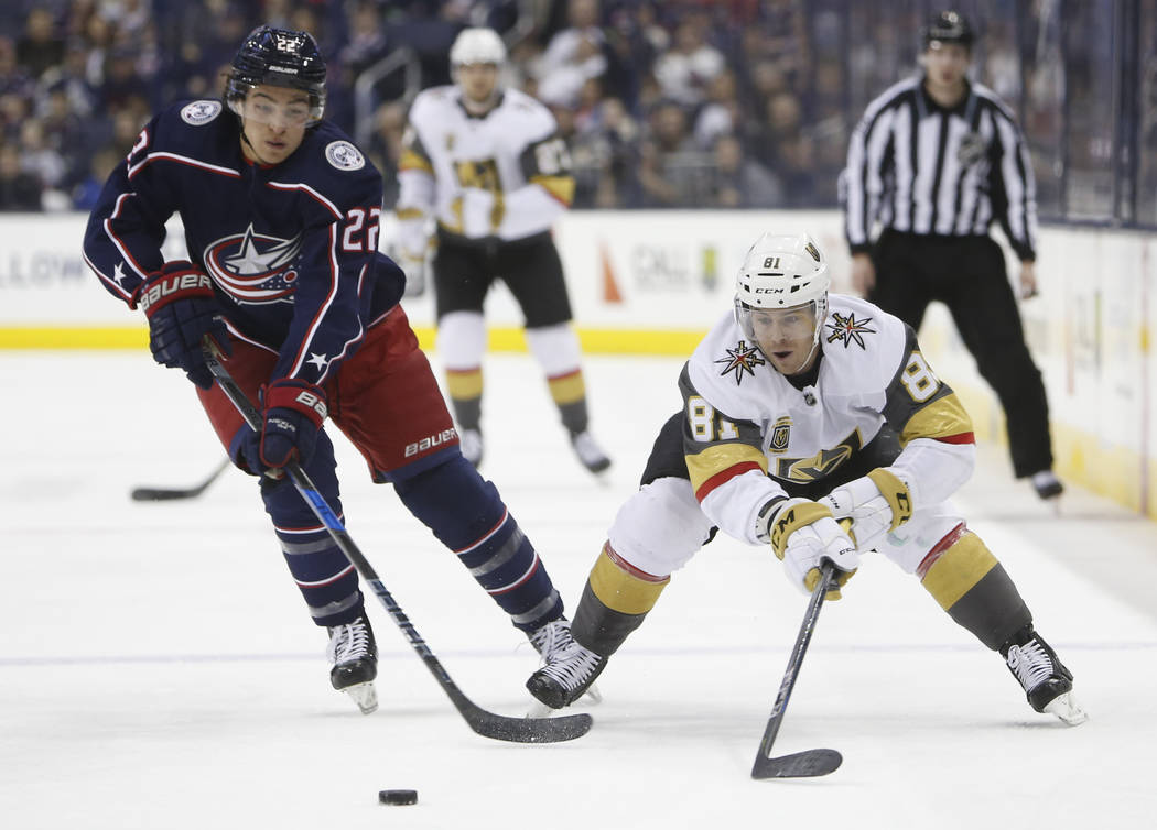 Las Vegas Golden Knights' Jonathan Marchessault, right, dumps the puck past Columbus Blue Jackets' Sonny Milano during the first period of an NHL hockey game Tuesday, March 6, 2018, in Columbus, O ...