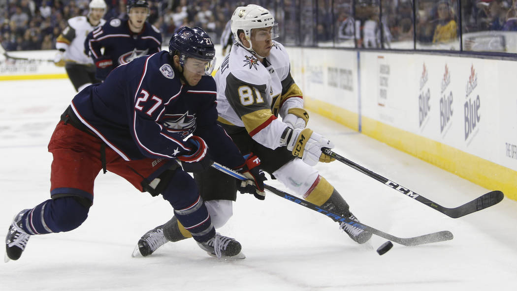 Columbus Blue Jackets' Ryan Murray, left, and Las Vegas Golden Knights' and Jonathan Marchessault chase the puck during the third period of an NHL hockey game Tuesday, March 6, 2018, in Columbus,  ...