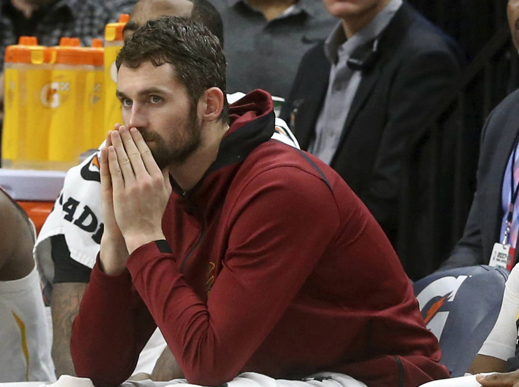 In this Jan. 8, 2018, file photo, Cleveland Cavaliers' Kevin Love watches from the bench in the second half of an NBA basketball game against the Minnesota Timberwolves in Minneapolis. (AP Photo/J ...