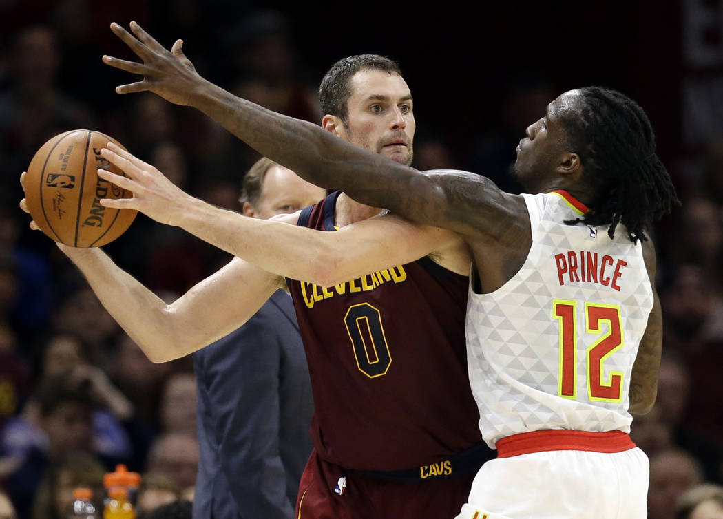 In this Nov. 5, 2017, file photo, Cleveland Cavaliers' Kevin Love (0) looks to pass against Atlanta Hawks' Taurean Prince (12) in the first half of an NBA basketball game in Cleveland. (AP Photo/T ...
