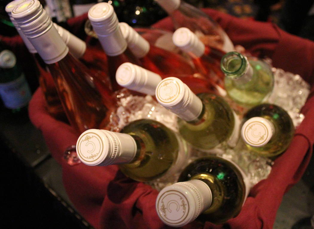 Bottles of assorted white wines being chilled before the taste sampling begins at UNLVino, Saturday, April 1, 2017. (Gabriella Benavidez/Las Vegas Review-Journal) @gabbydeebee