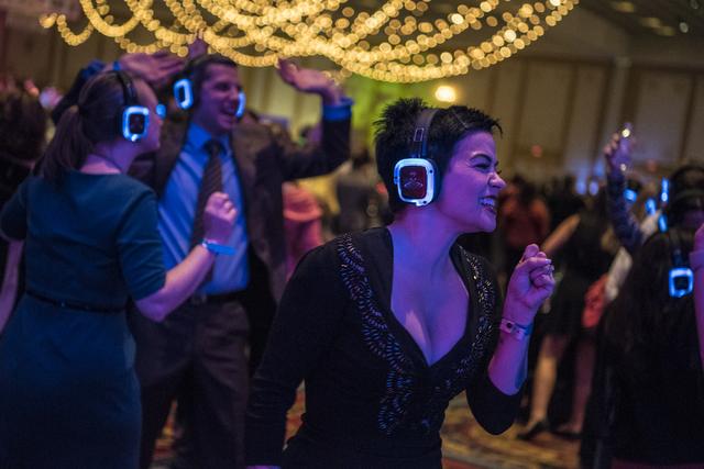 Erin Cooper dances in the silent disco during the UNLVino fundraiser at the Paris hotel-casino in Las Vegas on Saturday, April 16, 2016. (Joshua Dahl/Las Vegas Review-Journal)