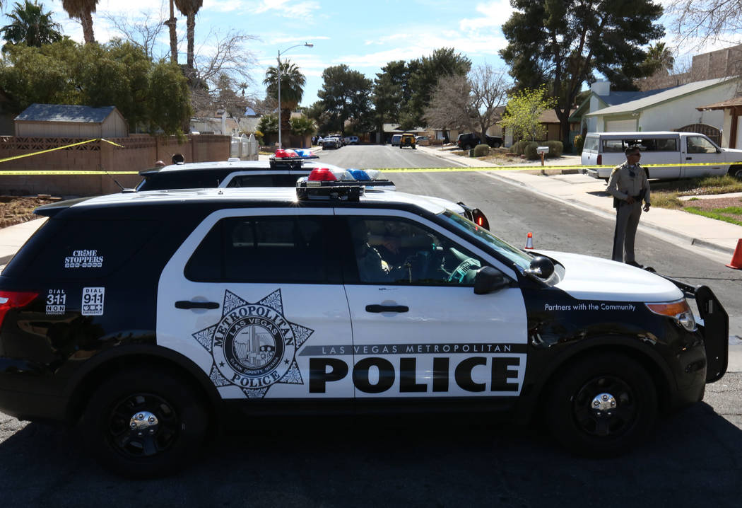 Las Vegas police block off Chutney Street as they investigate a double shooting at Bridle Court and Lasso Circle, near Flamingo Road and Boulder Highway on Tuesday, March 6, 2018, in Las Vegas. Tw ...