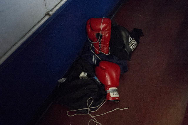 Red boxing gloves lay on the ground at Johnny Tocco's Ringside Gym in Las Vegas on Friday, Feb. 3, 2017. (Bridget Bennett/Las Vegas Review-Journal) @bridgetkb