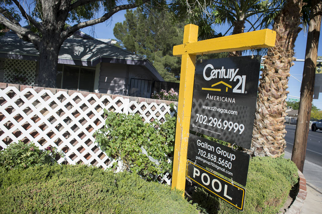 """A """"for sale"""" sign sit out front a home near the intersection of  West Washington Avenue and North Valley View Boulevard on Wednesday, May 3, 2017, in Las Vegas. Bridget Bennett Las Vegas ..."""