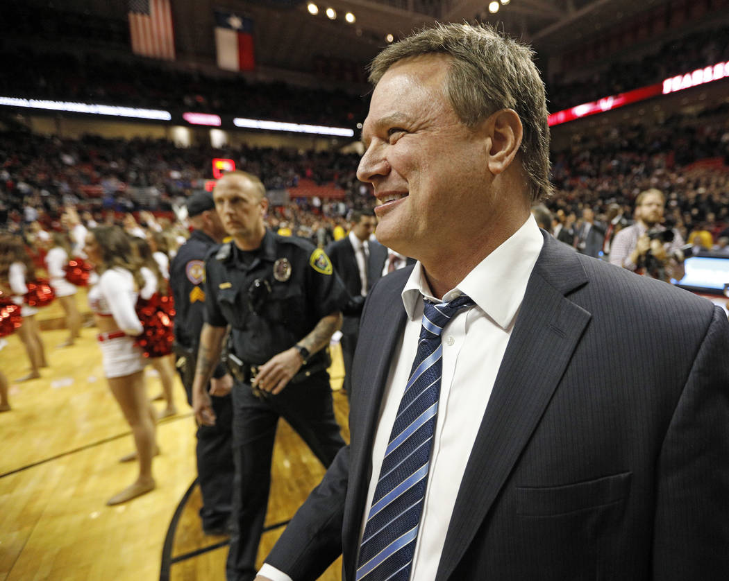 In this Feb. 24, 2018, file photo, Kansas coach Bill Self celebrates his team's victory over Texas Tech in an NCAA college basketball game, in Lubbock, Texas. (AP Photo/Brad Tollefson, File)
