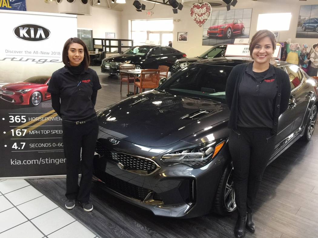 Findlay Findlay Kia sales consultants Priscilla Ramirez, left, and Veronica Rodriguez are seen with the popular 2018 Kia Stinger sports car at the dealership situated at 5325 W. Sahara Ave.