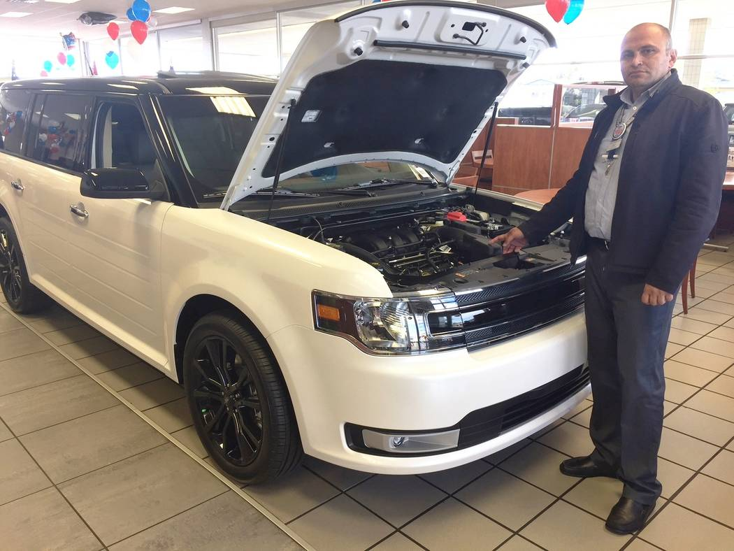 Friendly Ford Friendly Ford product trainer Grig Demirchyan shows off the 2018 Ford Flex Crossover at the dealership at 660 N. Decatur Blvd.