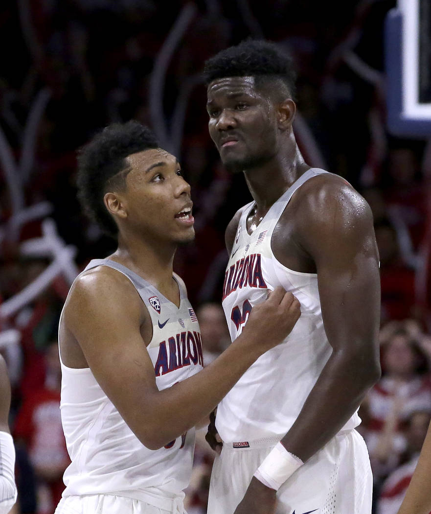 Arizona guard Allonzo Trier (35) and Deandre Ayton (13) in the second half during an NCAA college basketball game against Cal State Bakersfield, Thursday, Nov. 16, 2017, in Tucson, Ariz. Arizona d ...
