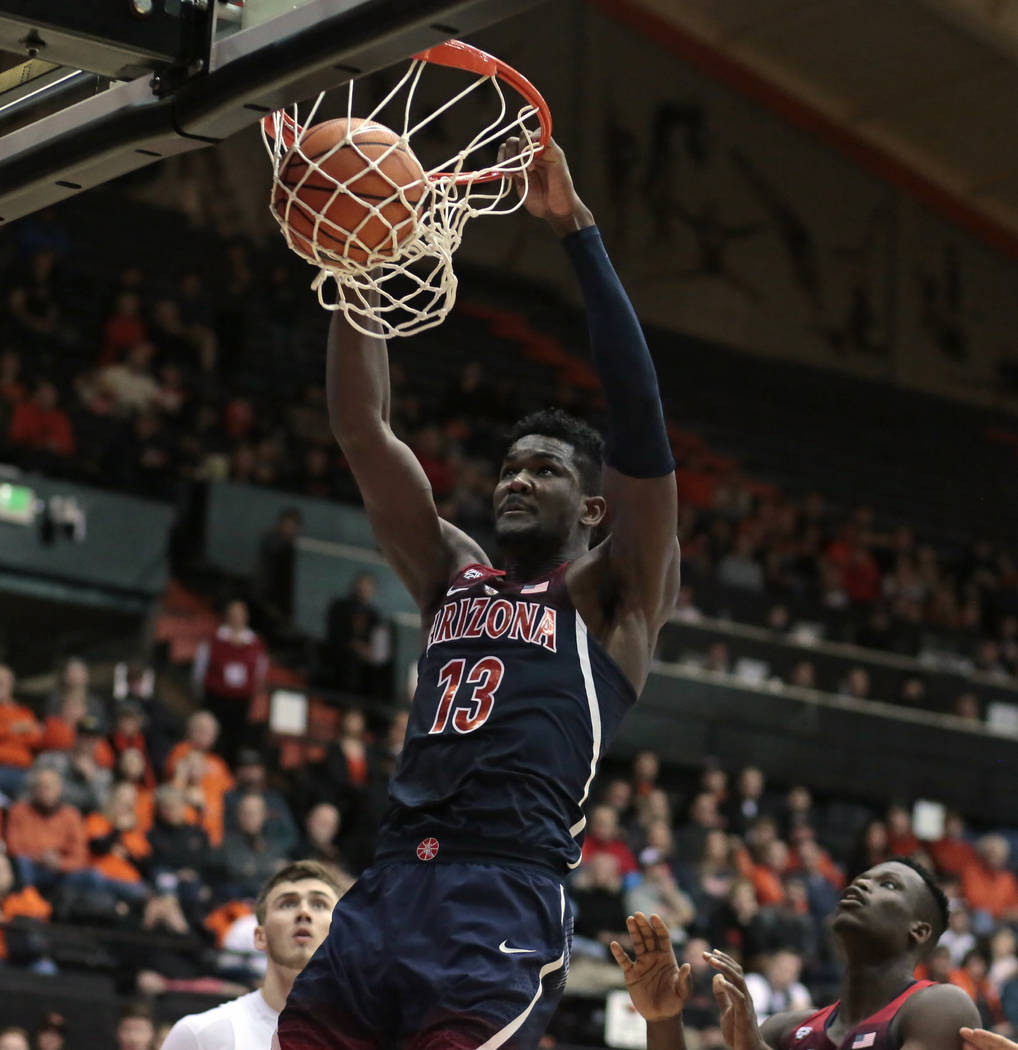 Arizona's Deandre Ayton (13) gets behind the Oregon State defense for a dunk during the second half of an NCAA college basketball game in Corvallis, Ore., Thursday, Feb. 22, 2018. Arizona won in o ...