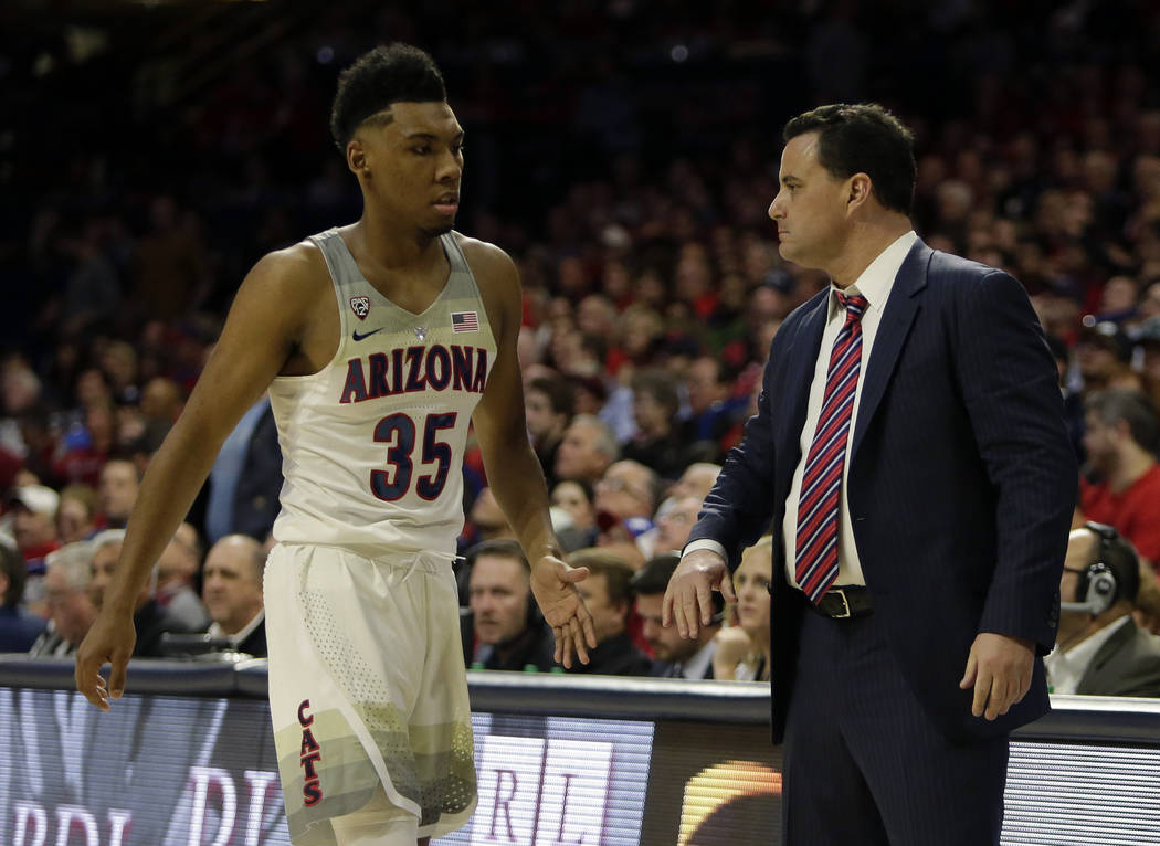 Arizona head coach Sean Miller and Allonzo Trier (35) in the first half during an NCAA college basketball game against Stanford, Thursday, March 1, 2018, in Tucson, Ariz. (AP Photo/Rick Scuteri)