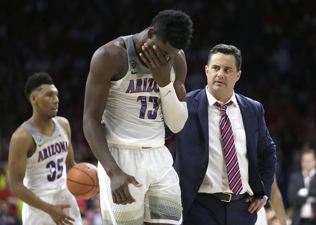 Arizona forward Deandre Ayton (13) and Sean Miller in the first half during an NCAA college basketball game against Stanford, Thursday, March 1, 2018, in Tucson, Ariz. (AP Photo/Rick Scuteri)