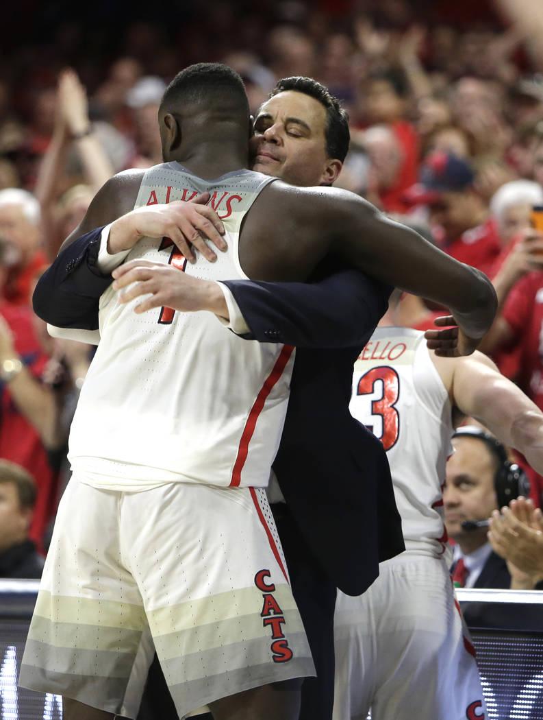Arizona head coach Sean Miller and Rawle Alkins (1) during an NCAA college basketball game against California, Saturday, March 3, 2018, in Tucson, Ariz. Arizona defeated California 66-64. (AP Phot ...