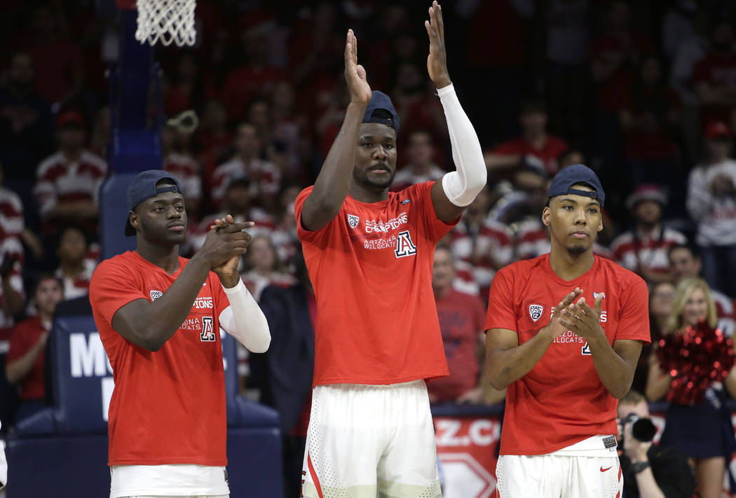 Arizona guard Rawle Alkins (1), left, Deandre Ayton, middle, and Allonzo Trier (35) during an NCAA college basketball game against California, Saturday, March 3, 2018, in Tucson, Ariz. Arizona def ...