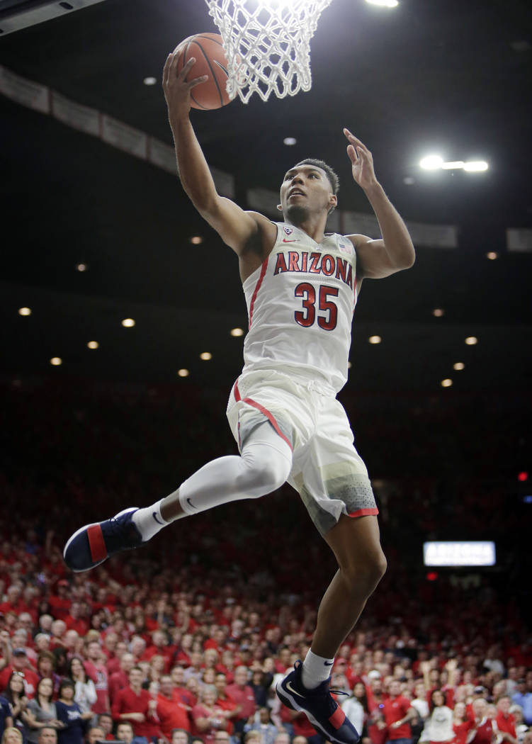 FILE - In this March 3, 2018, file photo, Arizona guard Allonzo Trier (35) scores against California during the second half of an NCAA college basketball game in Tucson, Ariz. Trier was selected t ...