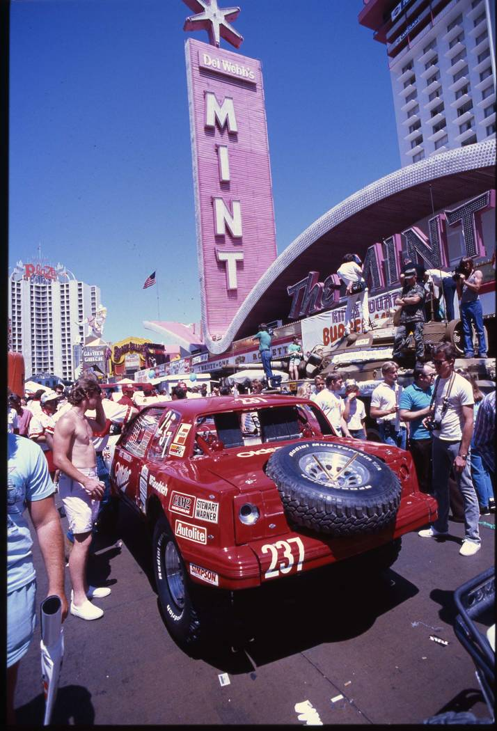 Race fans around the Class 2 car of Chris Robinson of Riverside, California on Fremont Street during tech inspection for the 20th running of the Nissan Mint 400 desert off-road race, 1987. (Las Ve ...
