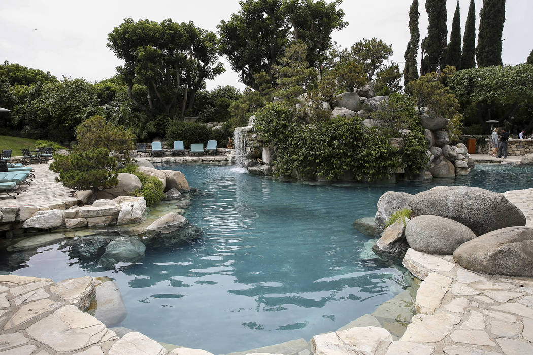 FILE - This May 11, 2016, file photo, shows an area of the grounds at the Playboy Mansion in Los Angeles. The new owner of the Playboy Mansion has agreed to maintain the facade in its original con ...