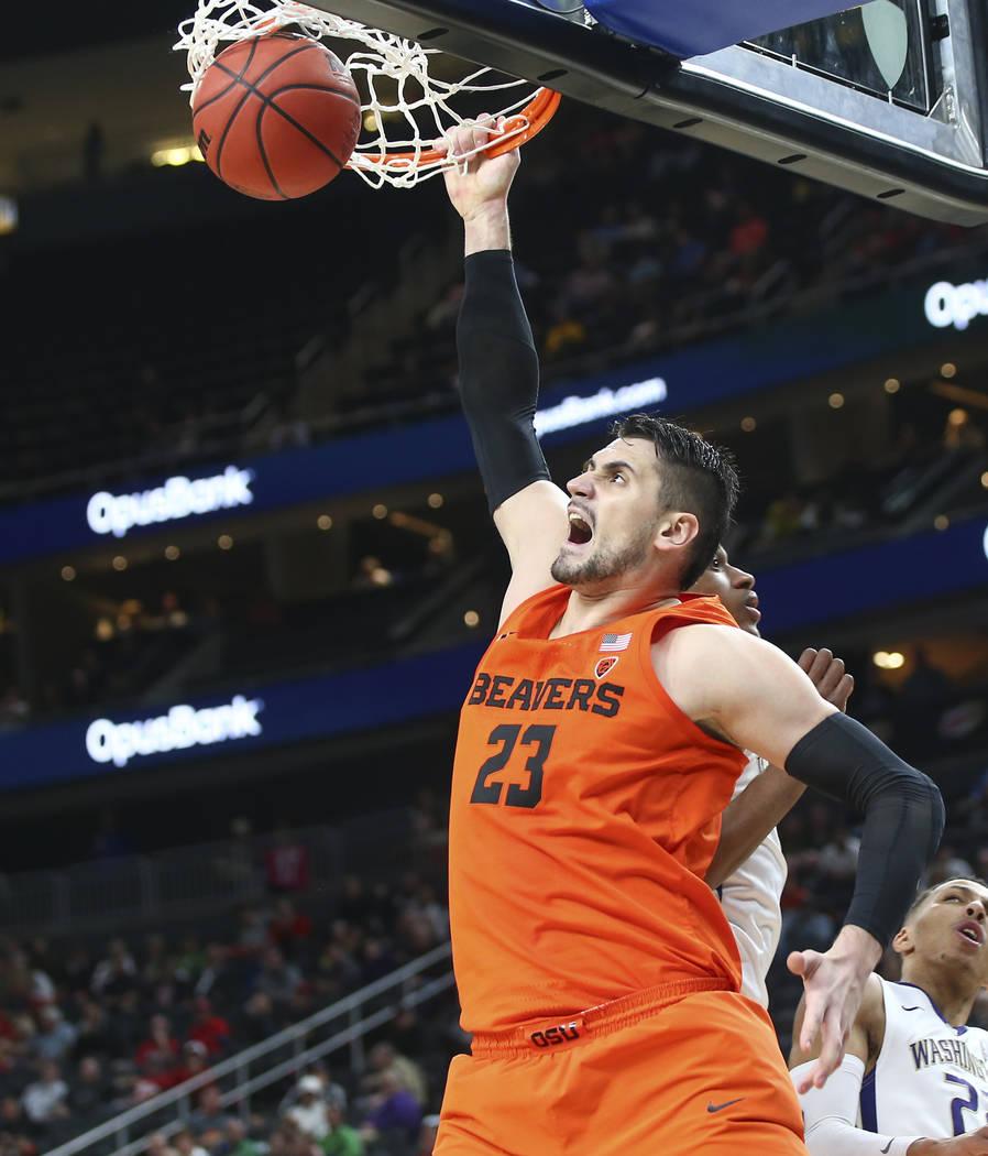 Oregon State Beavers center Gligorije Rakocevic (23) dunks against the Washington Huskies during the Pac-12 basketball tournament at T-Mobile Arena in Las Vegas on Wednesday, March 7, 2018. Oregon ...