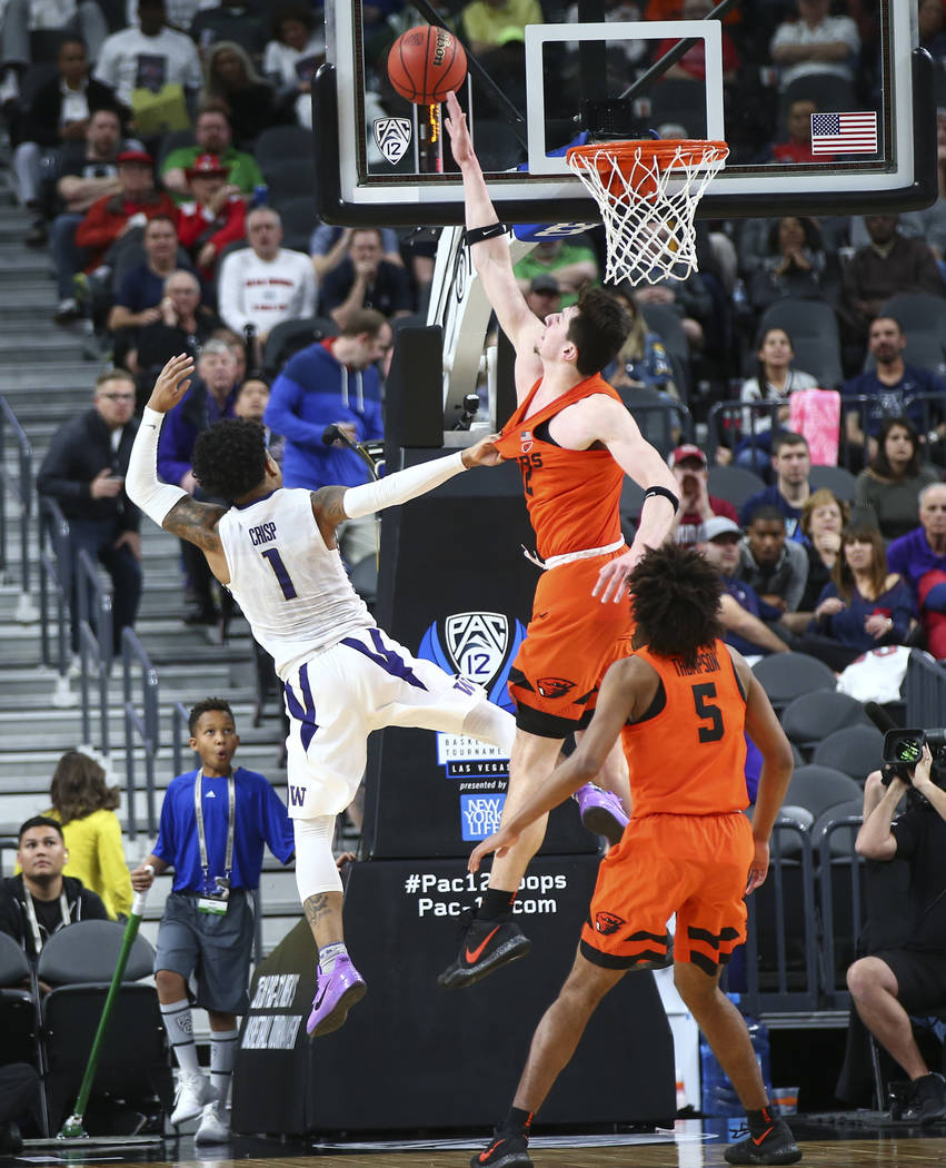 Oregon State Beavers forward Drew Eubanks (12) blocks a shot from Washington Huskies guard David Crisp (1) during the Pac-12 basketball tournament at T-Mobile Arena in Las Vegas on Wednesday, Marc ...