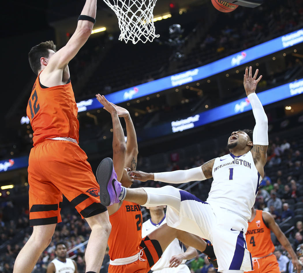 5cca2e49c26 Washington Huskies guard David Crisp (1) sends up a shot as Oregon State  Beavers