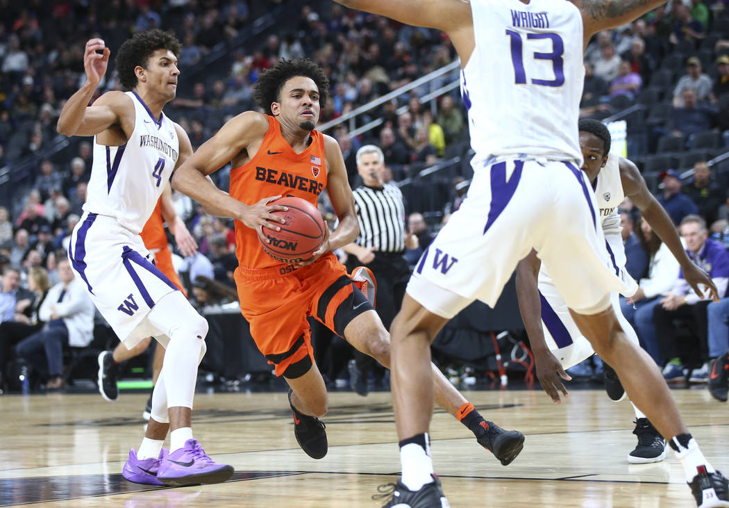 Oregon State Beavers guard Stephen Thompson Jr. (1) drives to the basket past Washington Huskies guard Matisse Thybulle (4) during the Pac-12 basketball tournament at T-Mobile Arena in Las Vegas o ...