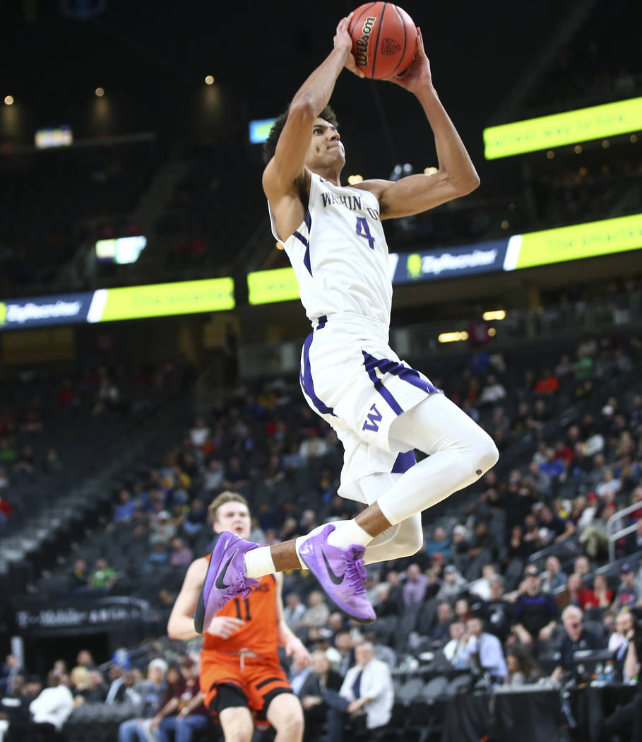 Washington Huskies guard Matisse Thybulle (4) goes to the basket against the Oregon State Beavers during the Pac-12 basketball tournament at T-Mobile Arena in Las Vegas on Wednesday, March 7, 2018 ...