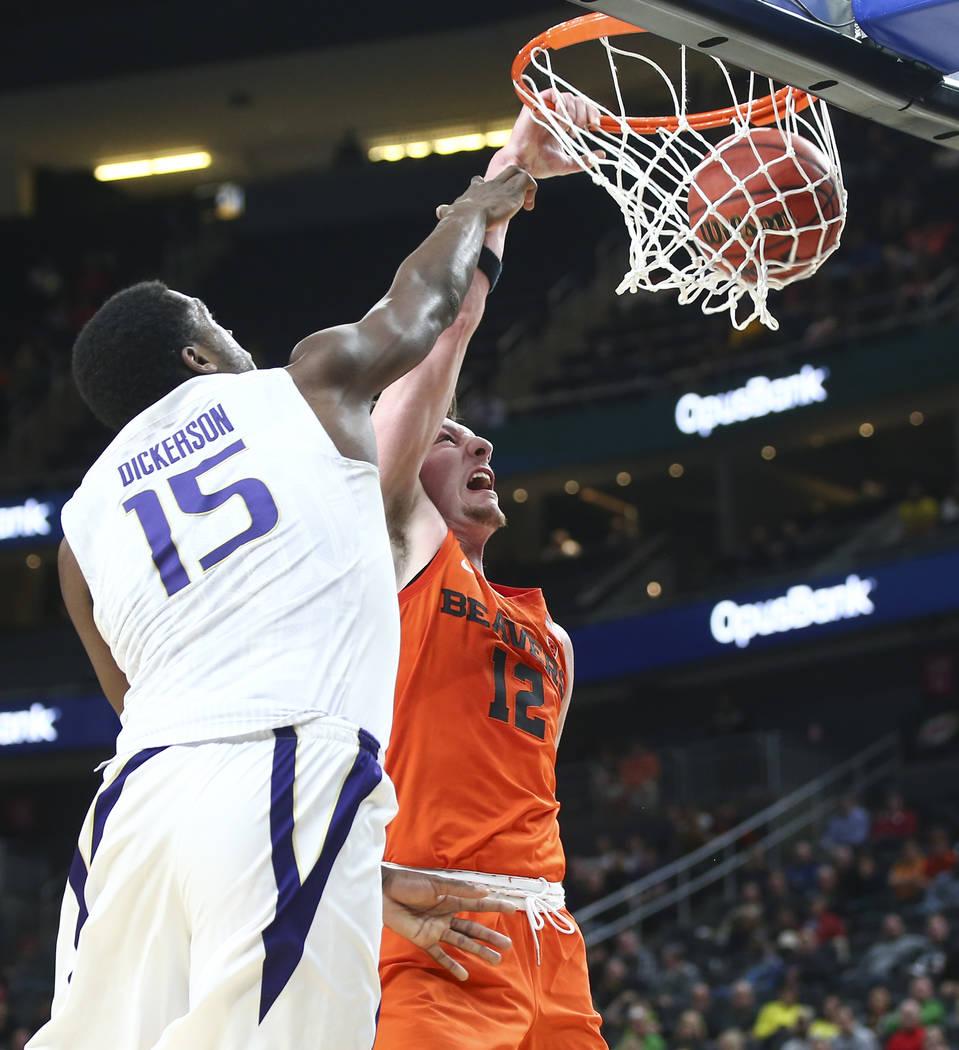 Oregon State Beavers forward Drew Eubanks (12) dunks against Washington Huskies forward Noah Dickerson (15) during the Pac-12 basketball tournament at T-Mobile Arena in Las Vegas on Wednesday, Mar ...