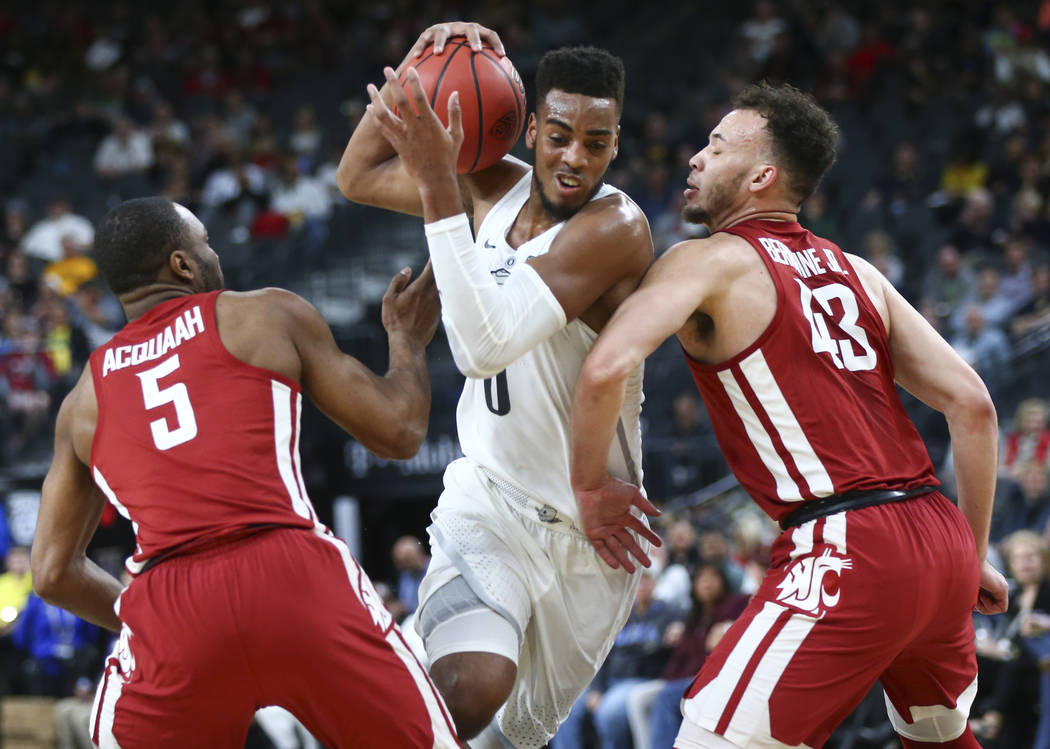 Oregon Ducks forward Troy Brown (0) drives to the basket as Washington State Cougars guard Milan Acquaah (5) and forward Drick Bernstine (43) defend during the Pac-12 basketball tournament at T-Mo ...