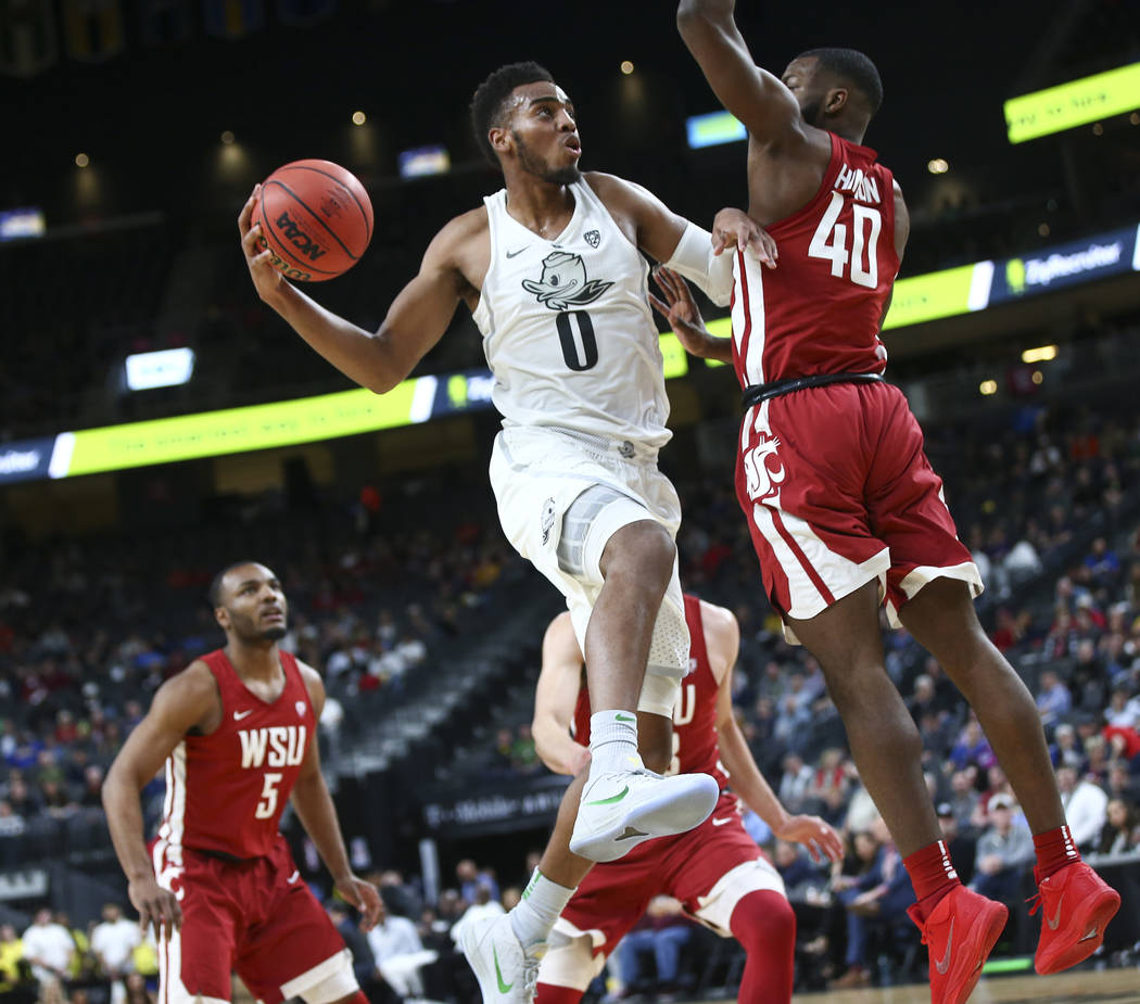 Oregon Ducks forward Troy Brown (0) shoots against Washington State Cougars guard Kwinton Hinson (40) during the Pac-12 basketball tournament at T-Mobile Arena in Las Vegas on Wednesday, March 7,  ...