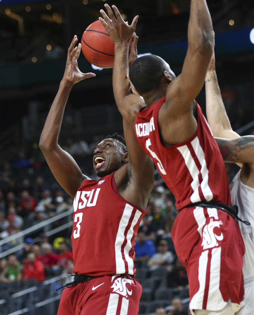 Washington State Cougars forward Robert Franks (3) gets a rebound against the Oregon Ducks during the Pac-12 basketball tournament at T-Mobile Arena in Las Vegas on Wednesday, March 7, 2018. Chase ...