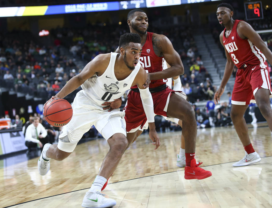 Oregon Ducks forward Troy Brown (0) drives against Washington State Cougars guard Kwinton Hinson (40) during the Pac-12 basketball tournament at T-Mobile Arena in Las Vegas on Wednesday, March 7,  ...