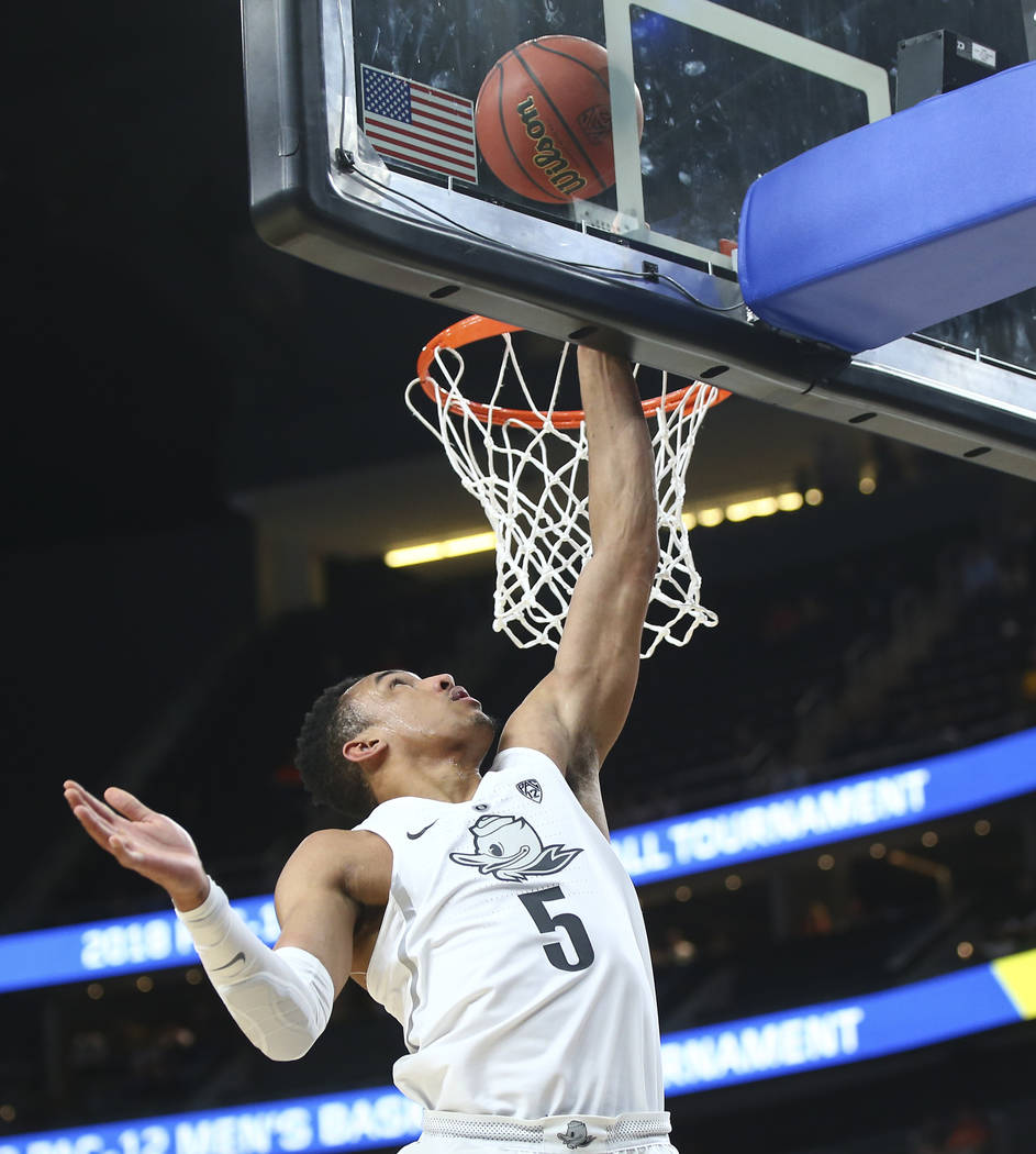 Oregon Ducks guard Elijah Brown (5) goes to the basket against the Washington State Cougars during the Pac-12 basketball tournament at T-Mobile Arena in Las Vegas on Wednesday, March 7, 2018. Chas ...
