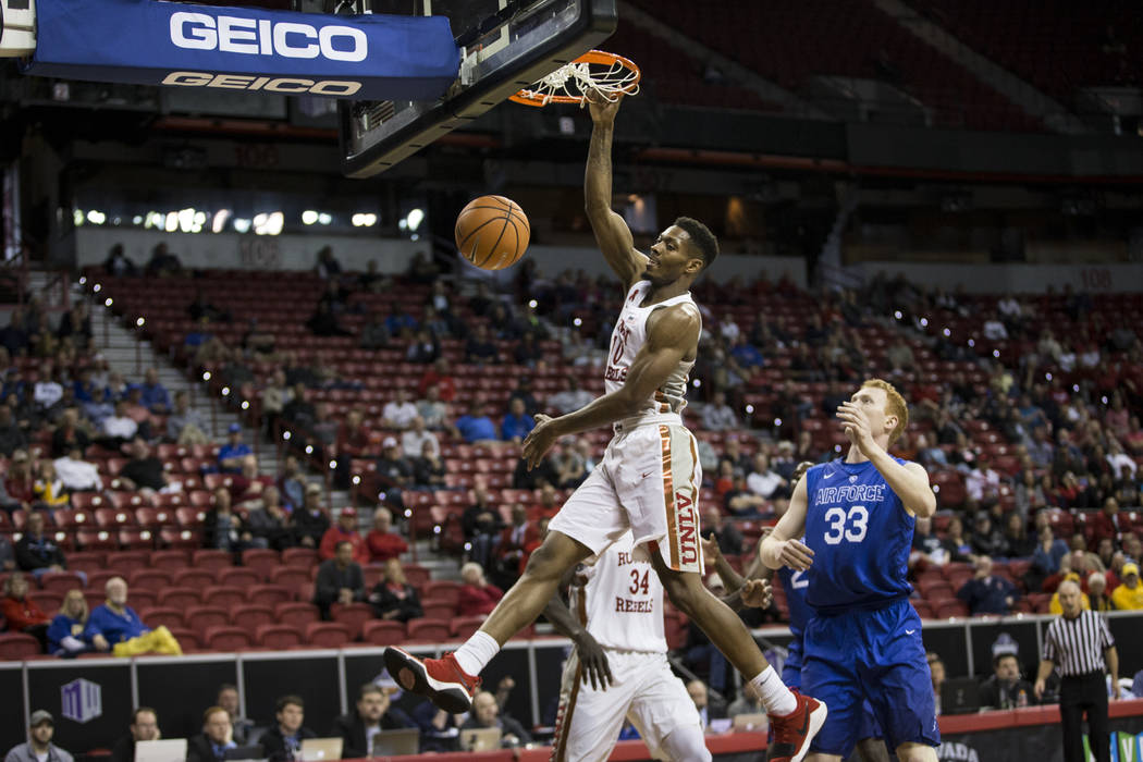 UNLV Rebels forward Shakur Juiston (10) dunks the ball as Air Force Falcons center Frank Toohey (33) looks on in the first half of the Mountain West Conference men's basketball tournament in Hende ...