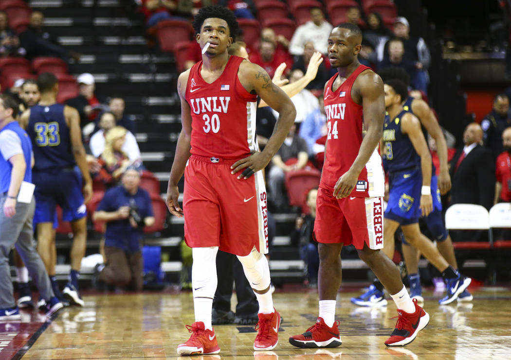 UNLV guard Jovan Mooring (30) and UNLV guard Jordan Johnson (24) in the final seconds of their basketball game against UNR at the Thomas & Mack Center in Las Vegas on Wednesday, Feb. 28, 2018. ...