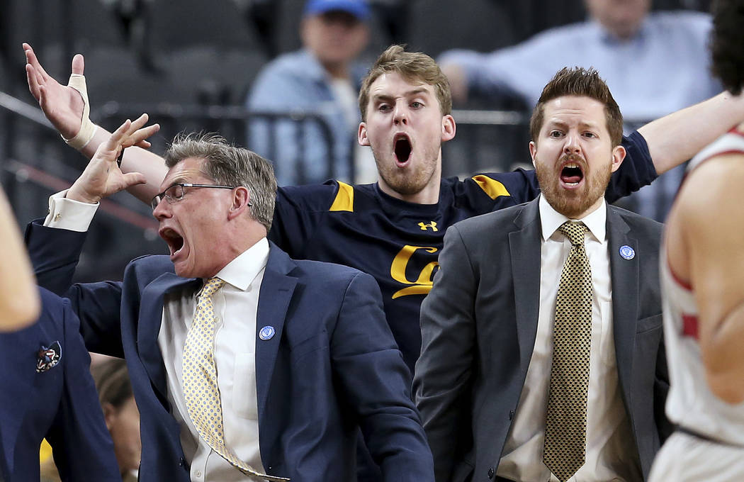 California's bench reacts to a call during the first half of an NCAA college basketball game against Stanford in the first round of the Pac-12 men's tournament Wednesday, March 7, 2018, in Las Veg ...