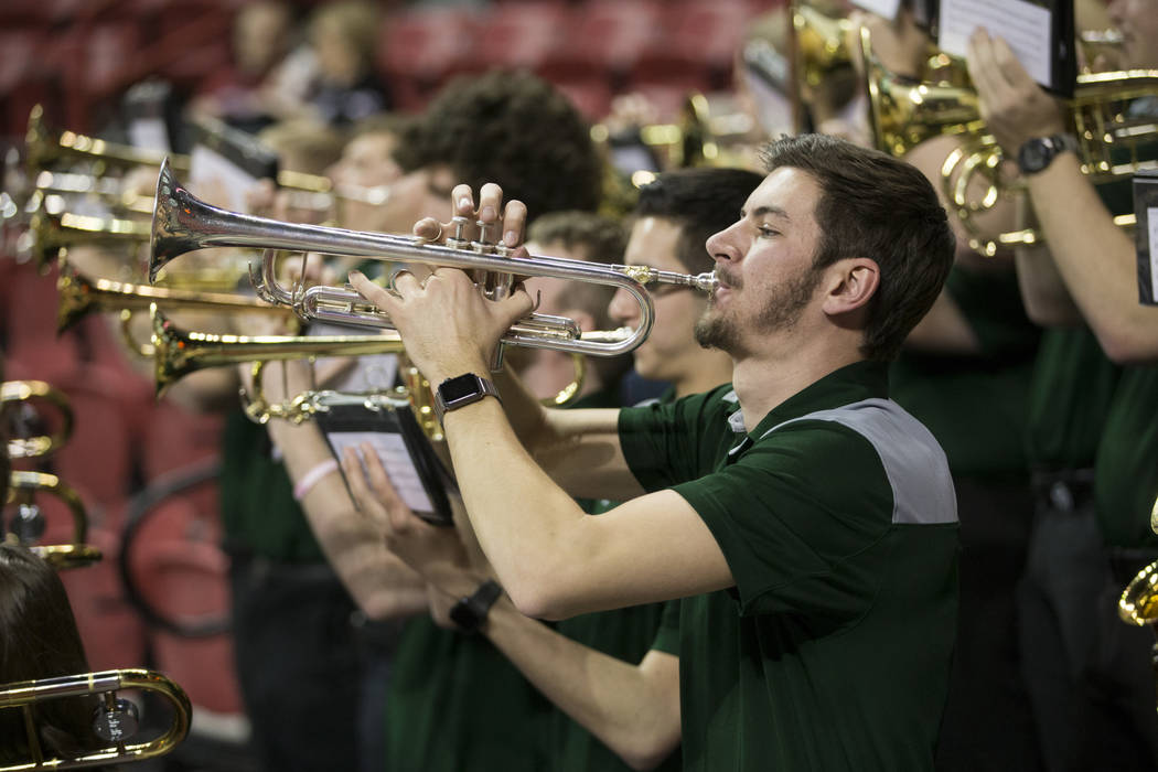 Colorado State Rams band member Chase Plant, 21, performs in a game against Boise State Broncos during the Mountain West Conference women's basketball tournament at the Thomas & Mack Center in ...