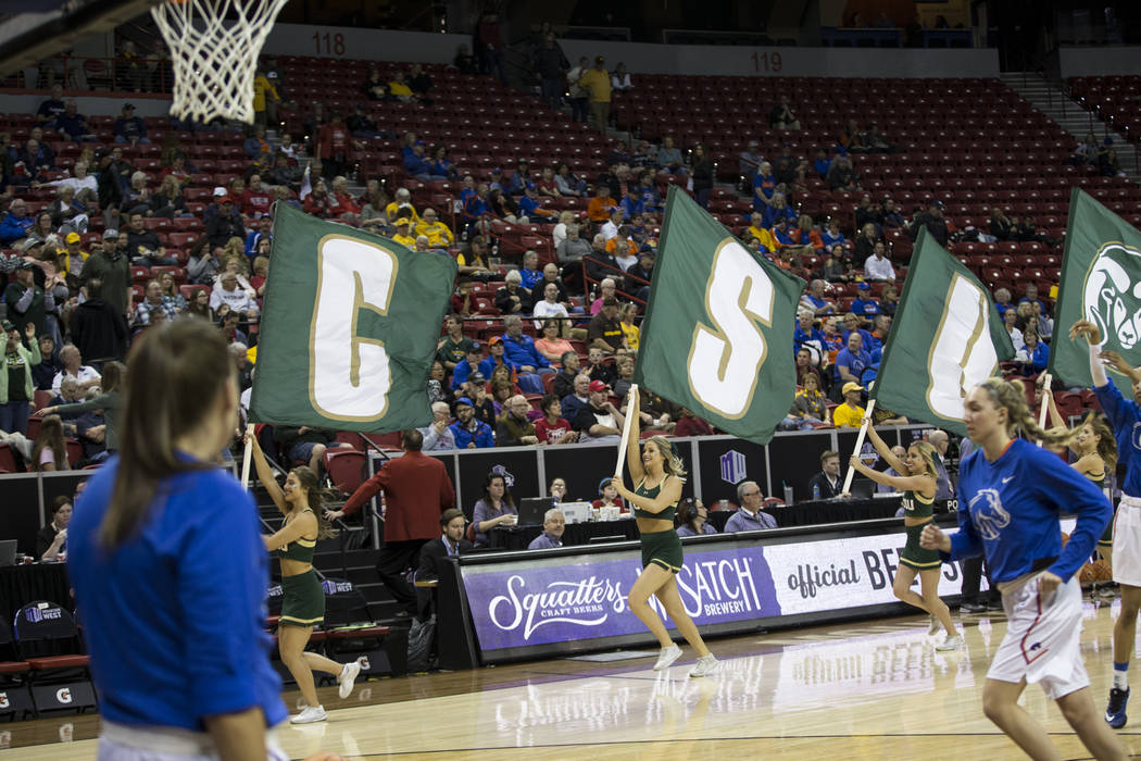 Colorado State Rams cheerleaders run up the courts with team flags before taking on Boise State Broncos in the  Mountain West Conference women's basketball tournament game at the Thomas & Mack ...