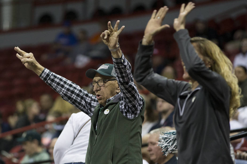 Fans react after Colorado State Rams scored a three-point shot against Boise State Broncos in the first half of the Mountain West Conference women's basketball tournament game at the Thomas &  ...
