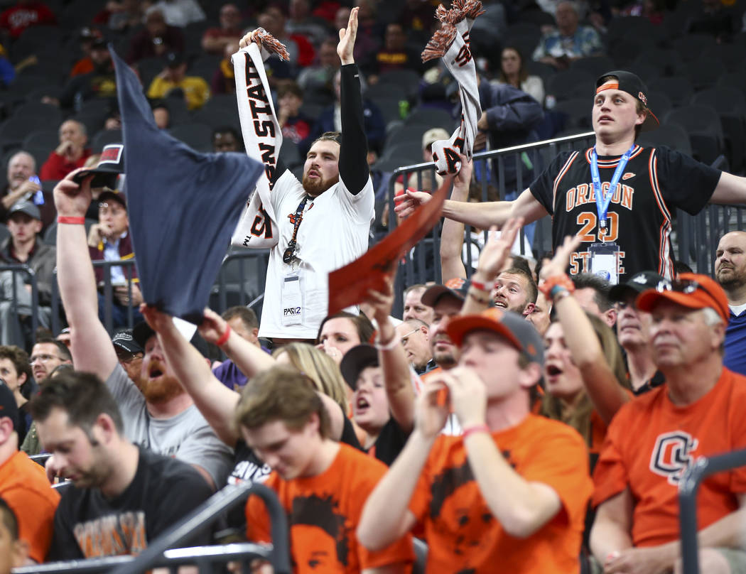 Oregon State Beavers fans cheer as their team plays the Washington Huskies during the Pac-12 basketball tournament at T-Mobile Arena in Las Vegas on Wednesday, March 7, 2018. Oregon State won 69-6 ...