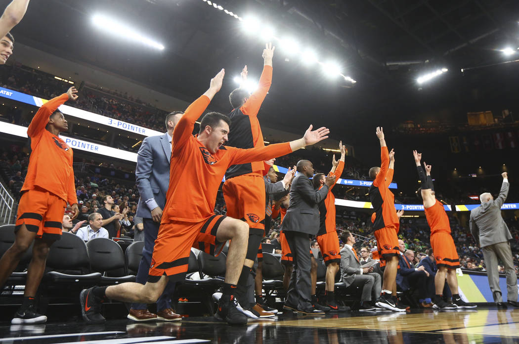 Oregon State Beavers players cheer as their team plays the Washington Huskies during the Pac-12 basketball tournament at T-Mobile Arena in Las Vegas on Wednesday, March 7, 2018. Oregon State won 6 ...