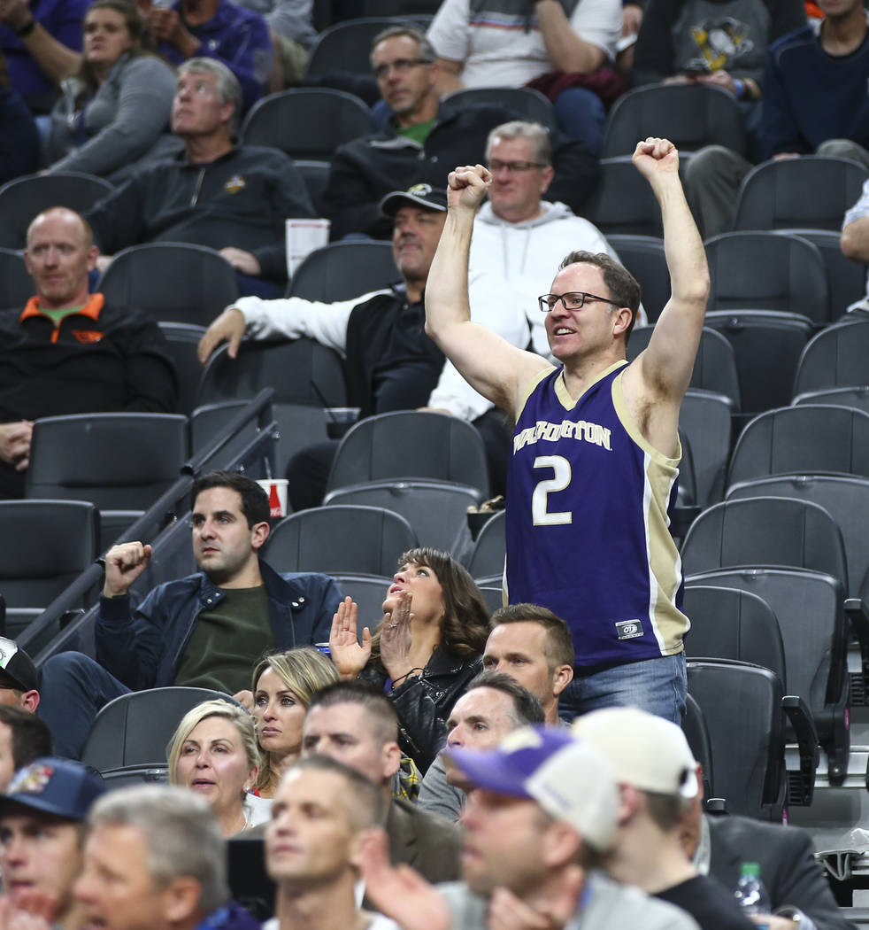 A Washington Huskies fan cheers as the team plays the Oregon State Beavers during the Pac-12 basketball tournament at T-Mobile Arena in Las Vegas on Wednesday, March 7, 2018. Oregon State won 69-6 ...