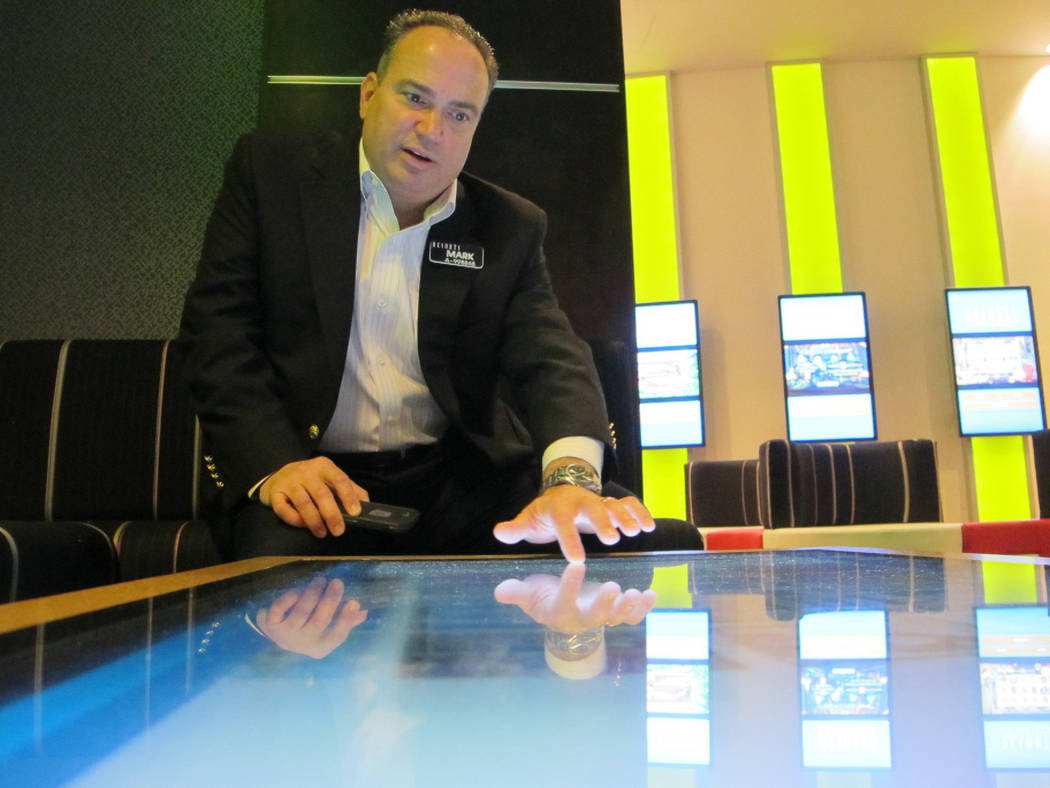 Mark Giannantonio, president of Resorts Casino Hotel in Atlantic City N.J. demonstrates a tabletop internet gambling console at his casino, April 15, 2015. (AP Photo/Wayne Parry, File)