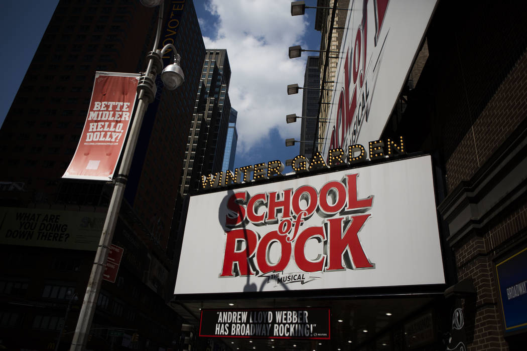 On Tuesday, July 18, 2017, the Winter Garden theatre displays an ad for School of Rock the musical on Broadway in New York. (AP Photo/Michael Noble Jr.)