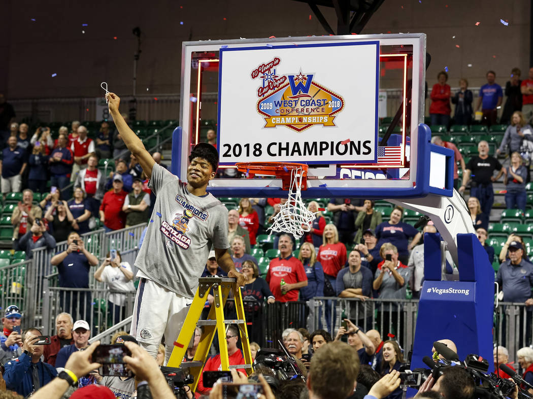 Gonzaga Bulldogs forward Rui Hachimura (21) cuts the net after the Bulldogs defeated the BYU Cougars 74-54 in the West Coast Conference championship game at the Orleans Arena in Las Vegas on Tuesd ...