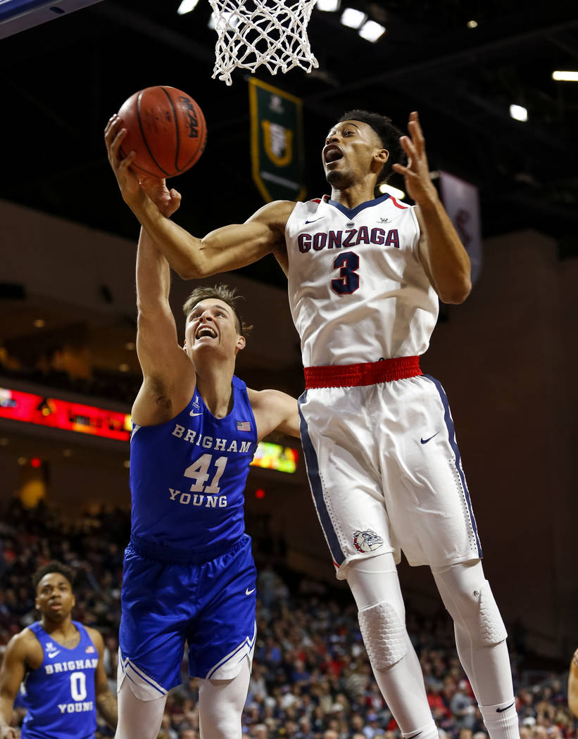 Gonzaga Bulldogs forward Johnathan Williams (3) and Brigham Young Cougars forward Luke Worthington (41) vie for the rebound during the West Coast Conference championship game at the Orleans Arena  ...