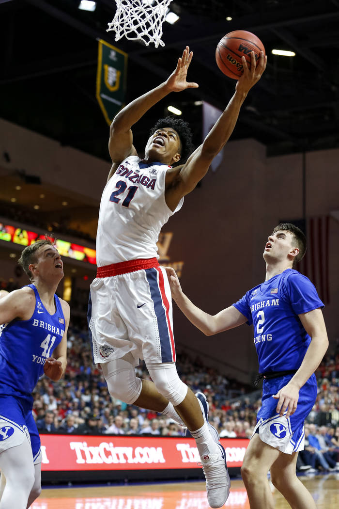 Gonzaga Bulldogs forward Rui Hachimura (21) goes up for a shot against the Brigham Young Cougars during the West Coast Conference championship game at the Orleans Arena in Las Vegas on Tuesday, Ma ...