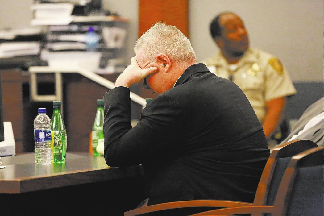 Jarom Boyes, a U.S. airmen accused of fatally shooting his wife Melissa Boyes, covers his eyes as he listens to an audio recording of the shooting during his murder trial at the Regional Justice C ...