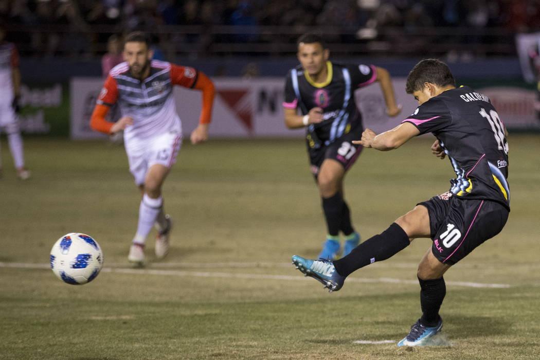 Las Vegas Lights FC's Juan Jose Calderon (10) scores a penalty kick during the second half of the exhibition soccer game at Cashman Field in Las Vegas, Saturday, Feb. 24, 2018. Erik Verduzc ...