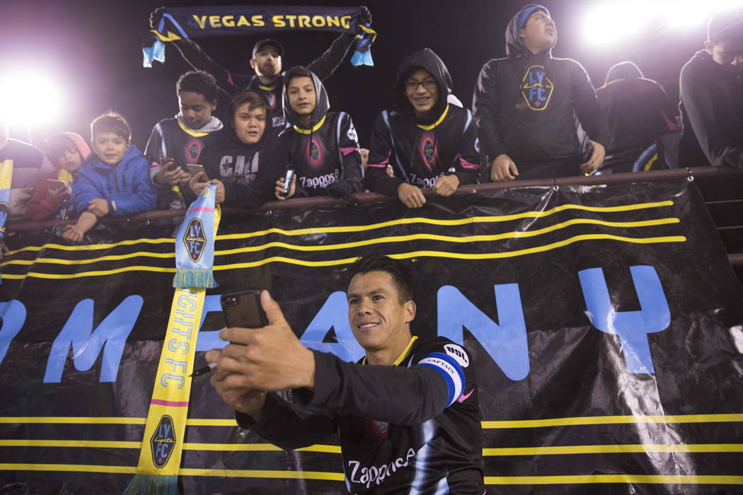 Las Vegas Lights FC's Marcelo Alatorre (16) takes a photo with fans after the exhibition soccer game against D.C. United at Cashman Field in Las Vegas, Saturday, Feb. 24, 2018. The Lights F ...