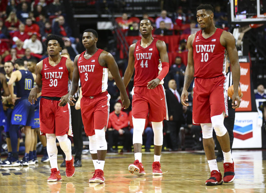 UNLV players at the start of a time out during the second half of a basketball game against UNR at the Thomas & Mack Center in Las Vegas on Wednesday, Feb. 28, 2018. UNR won 101-75. Chase Stev ...